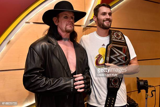 Wrestler The Undertaker poses for a photo with Kevin Love of the Cleveland Cavaliers before the game against the New York Knicks on October 25 2016...