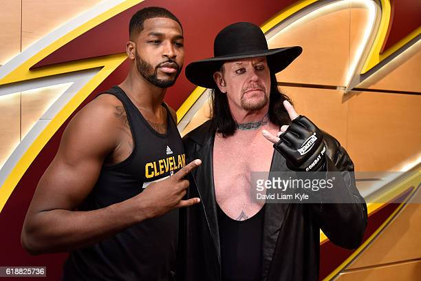 Wrestler The Undertaker poses for a photo with Tristan Thompson of the Cleveland Cavaliers before the game against the New York Knicks on October 25...