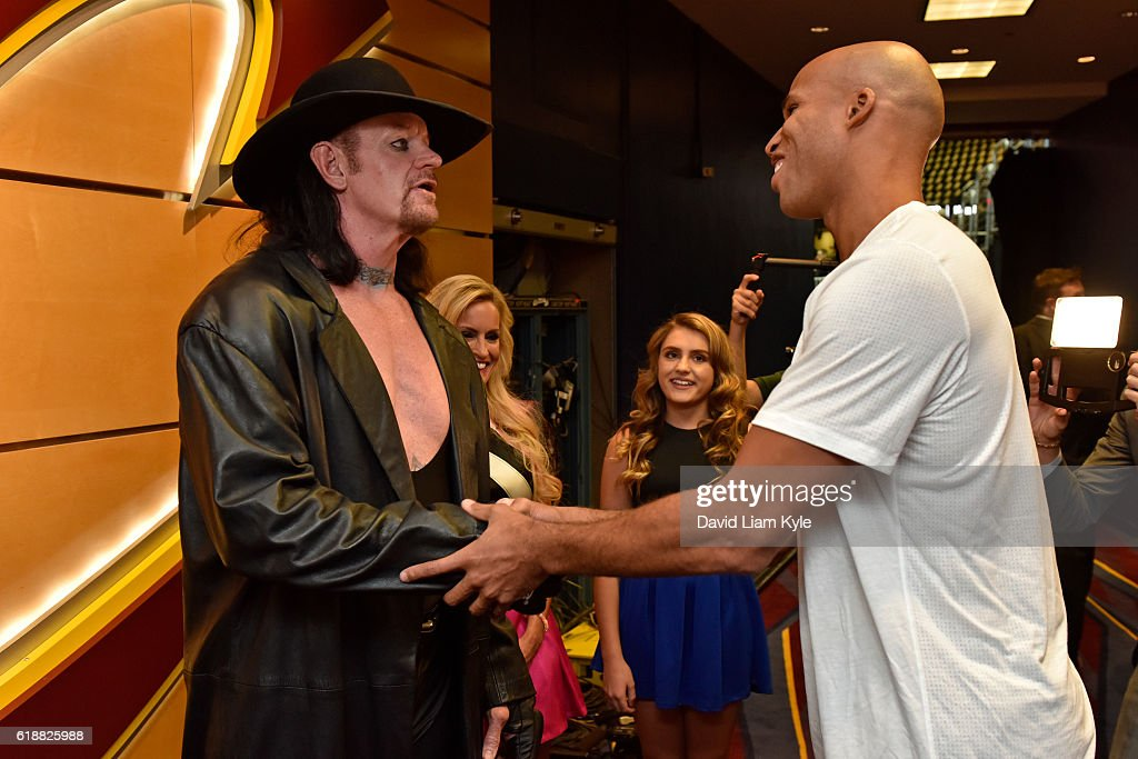 Wrestler, The Undertaker shakes hands with Richard Jefferson #24 of the Cleveland Cavaliers before the game against the New York Knicks on October 25, 2016 at Quicken Loans Arena in Cleveland, Ohio.