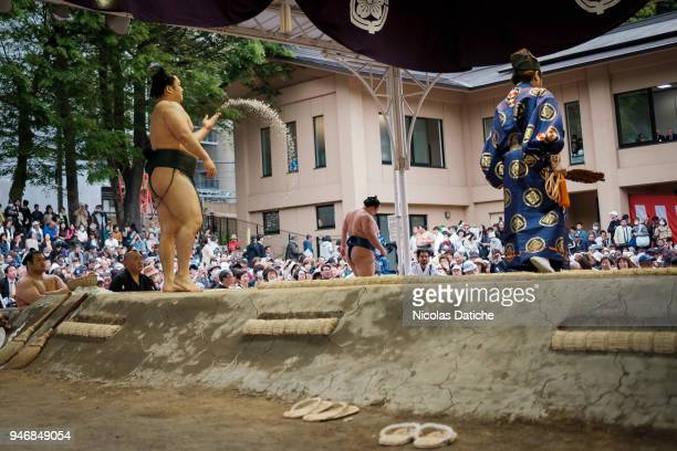 Wrestler throws salt during 'Honozumo' ceremonial on April 16, 2018 in Tokyo, Japan. This annual offering of a Sumo Tournament to the divine at the...