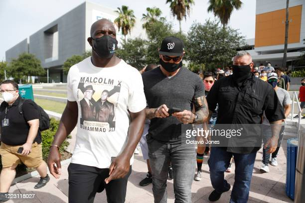 WWE wrestler Titus O'Neil and actor Dave Bautista lead the Love Walk with several hundred supporters from Curtis Hixon Park on June 27 2020 in Tampa...
