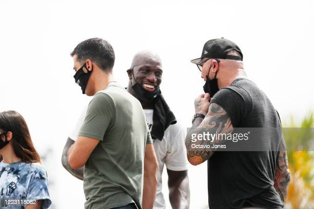 WWE wrestler Titus O'Neil and actor Dave Bautista share a laugh during the Love Walk on June 27 2020 in downtown Tampa Florida Thaddeus Bullard also...