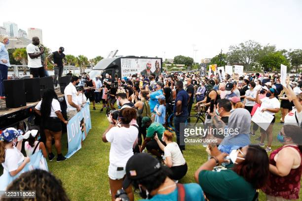 WWE wrestler Titus O'Neil and actor Dave Bautista talk with the supporters of the Love Walk at Julia B Lane Park on June 27 2020 in downtown Tampa...