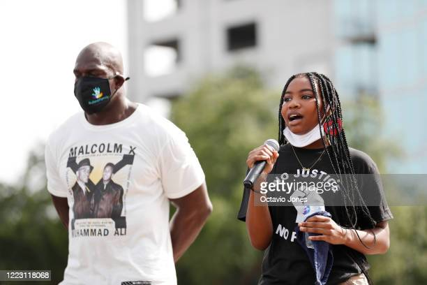WWE wrestler Titus O'Neil looks on while Kayla Blaine sings Lift Every Voice and Sing the Black National Anthem before the start of the Love Walk on...