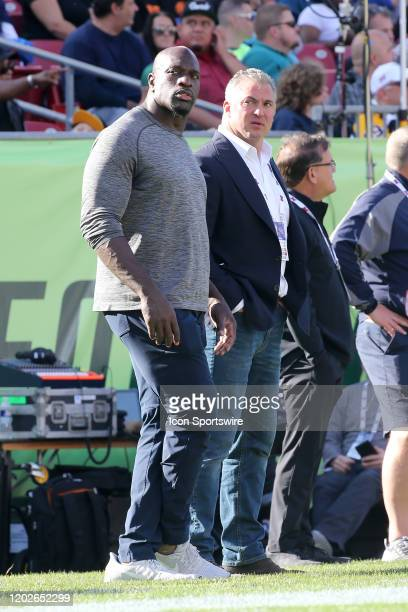 WWE wrestler Titus O'Neil stands with XFL WWE executive Shane McMahon during the regular season game between the Houston Roughnecks and the Tampa Bay...