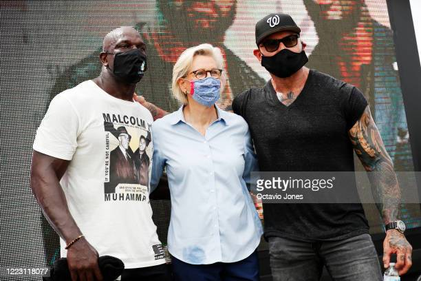 WWE wrestler Titus O'Neil Tampa Mayor Jane Castor and actor Dave Bautista take a photo during the Love Walk on June 27 2020 in downtown Tampa Florida...