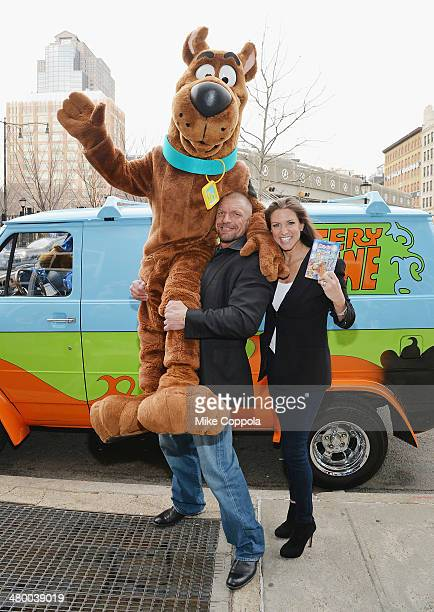 WWE wrestler Triple H and Stephanie McMahon lift Scooby Doo in the air during the 'Scooby Doo WrestleMania Mystery' New York Premiere at Tribeca...