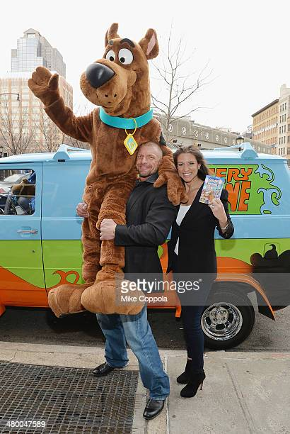 WWE wrestler Triple H and Stephanie McMahon lift Scooby Doo in the air during the Scooby Doo WrestleMania Mystery New York Premiere at Tribeca...