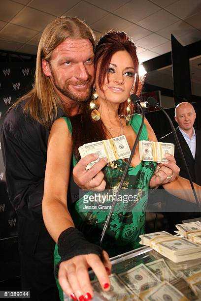 Wrestler Triple H and WWE diva Maria Kanellis attend a press conference announcing that WWE Chairman Vince McMahon will be giving away one million...