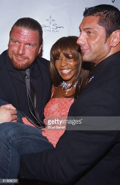 Wrestler Triple H Free and wrestler Batista arrives to the Break 2004 Celebrity Pool Tournament at Slate on September 14 2004 in New York