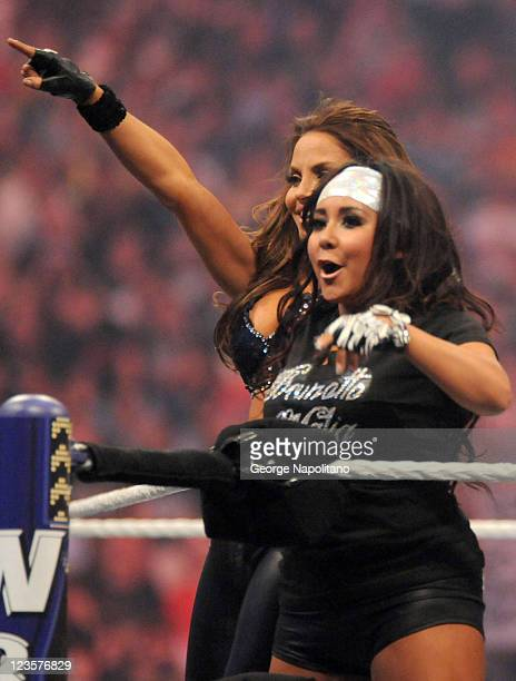 Wrestler Trish Stratus and Nicole Snooki Polizzi perform for WrestleMania XXVII at Georgia Dome on April 3 2011 in Atlanta Georgia