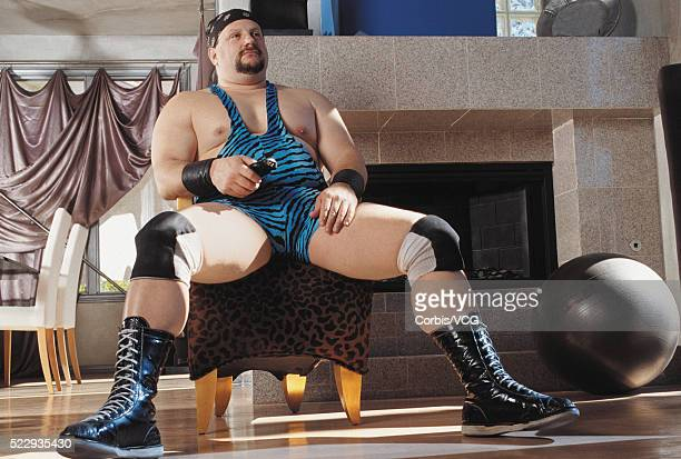wrestler using a remote control - vintage wrestling stock pictures, royalty-free photos & images