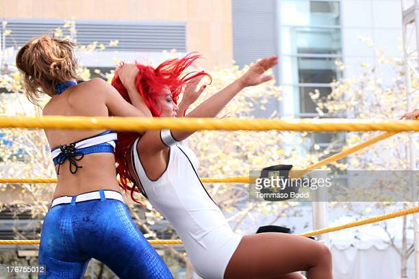 Wrestler/journalist Maria Menounos and WWE Diva Eva Marie attend the WWE and E's Total Divas takeover of SummerSlam held at Nokia Plaza LA LIVE on...