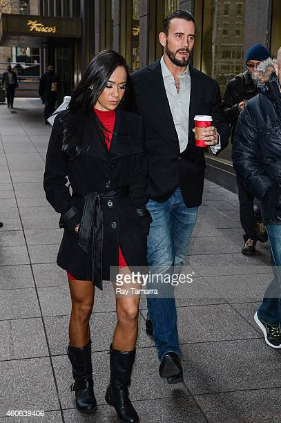 Wrestlers AJ Lee and CM Punk enter the Sirius XM Studios on December 18 2014 in New York City