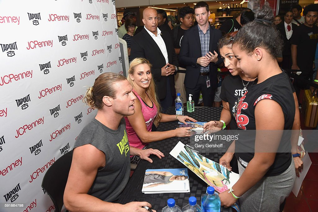 WWE Wrestlers Dolph Ziggler and Charlotte Promote Tapout Women's Line : News Photo