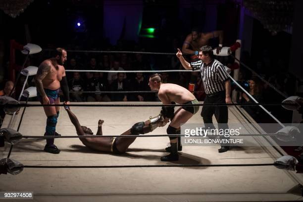 Wrestlers are pictured during a show on March 11 in Nanterre near Paris In Nanterre the French Association of Professional Wrestling revives French...