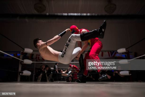 TOPSHOT Wrestlers are pictured during a show on March 11 in Nanterre near Paris In Nanterre the French Association of Professional Wrestling revives...