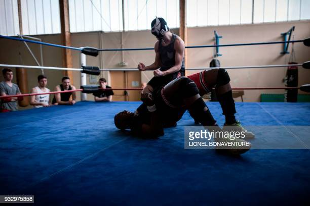 Wrestlers are pictured during a training session on March 10 in Nanterre, near Paris. - In Nanterre, the French Association of Professional Wrestling...