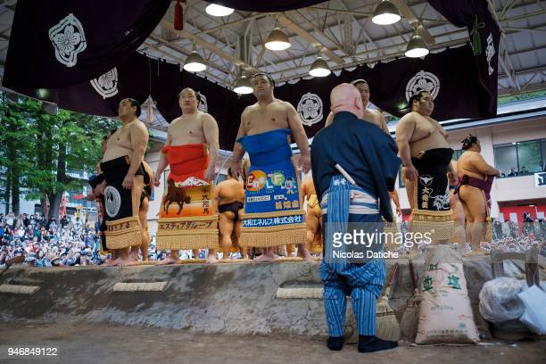 Wrestlers attend 'Honozumo' ceremonial on April 16 2018 in Tokyo Japan This annual offering of a Sumo Tournament to the divine at the Yasukuni Shrine...
