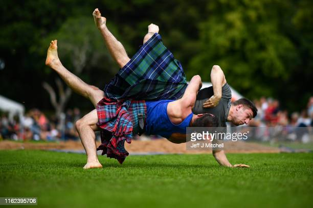 Wrestlers compete at Inveraray Highland Games on July 16 2019 in Inverarary Scotland The Games celebrate Scottish culture and heritage with field and...