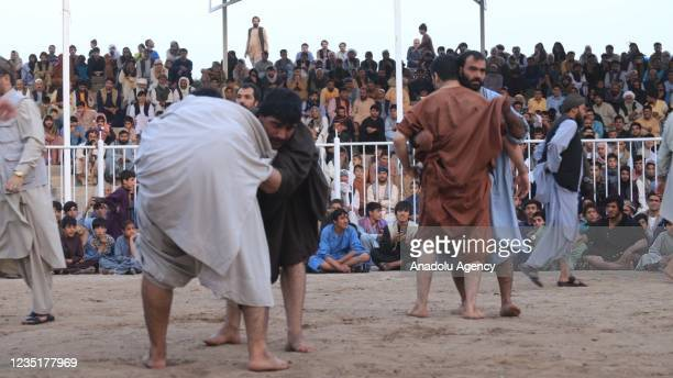 Wrestlers compete during the traditional wresting competition in Herat, Afghanistan on September 11, 2021. A scores of people followed the matches.