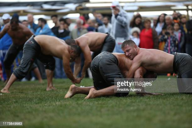 Wrestlers compete in a oil wrestling match during the 4th Etnospor Culture Festival held at Ataturk Airport, Istanbul, Turkey on October 05, 2019....