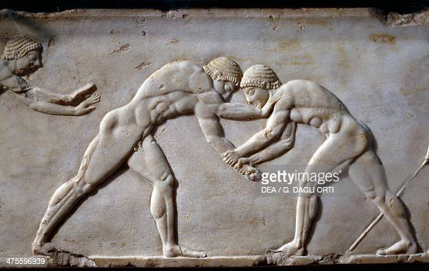 Wrestlers decorative detail from stele depicting a wrestling match between athletes ca 510 BC from the Kerameikos cemetery Athens Greece Greek...