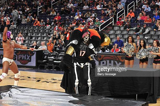 Wrestlers El Hijo Del Fantasma and La Parka attend Latin Night with the Phoenix Suns during the game against the San Antonio Spurs on December 15...