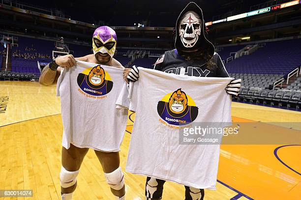 Wrestlers El Hijo Del Fantasma and La Parka pose for a picture before the game between the Phoenix Suns and the San Antonio Spurs on December 15 2016...