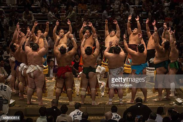 Wrestlers enter the ring during the Tokyo Grand Sumo tournament at the Ryogoku Kokugikan on September 17 2015 in Tokyo Japan Japanese Sumo is an...