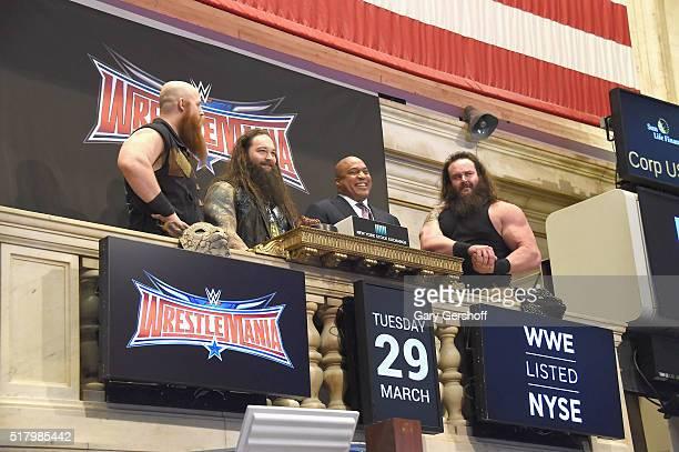 WWE wrestlers Erik Rowan and Bray Wyatt Global Head of Capital Markets at NYSE Garvis Toler and WWE wrestler Braun Strowman ring the New York Stock...
