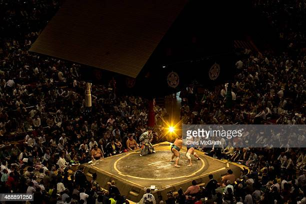 Wrestlers fight during the Tokyo Grand Sumo tournament at the Ryogoku Kokugikan on September 16, 2015 in Tokyo, Japan. Japanese Sumo is an anciant...