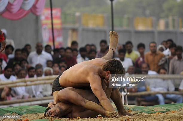 Wrestlers fight during Wrestling Title Championship at Gari Chaukhandi village on October 27 2014 in Noida India Thousands of wrestlers including...