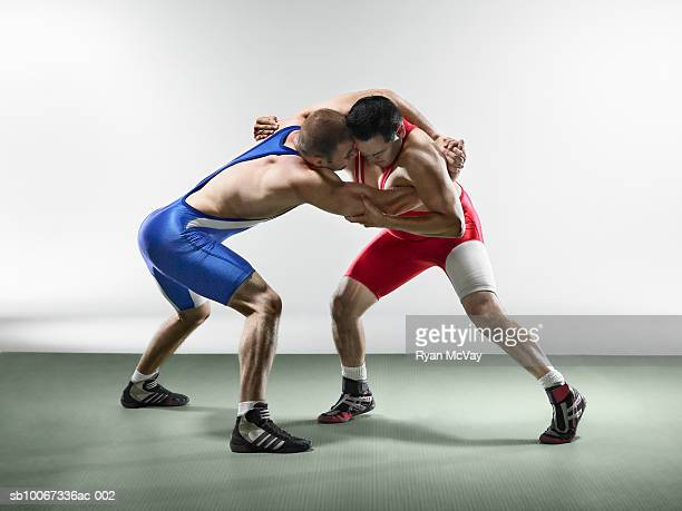 wrestlers fighting (studio shot) - wrestling stock pictures, royalty-free photos & images