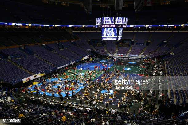Wrestlers gather on the mats for skin checks and weigh-ins before session three of the NCAA Wrestling Championships on March 17, 2017 at the...