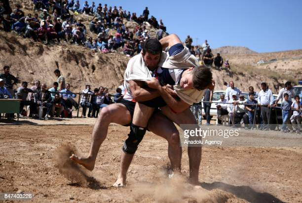 Wrestlers in action during a wrestling match ''Ba Çuhe'' which is registered as a wrestling sport in 1996 in Bojnurd Iran on September 15 2017