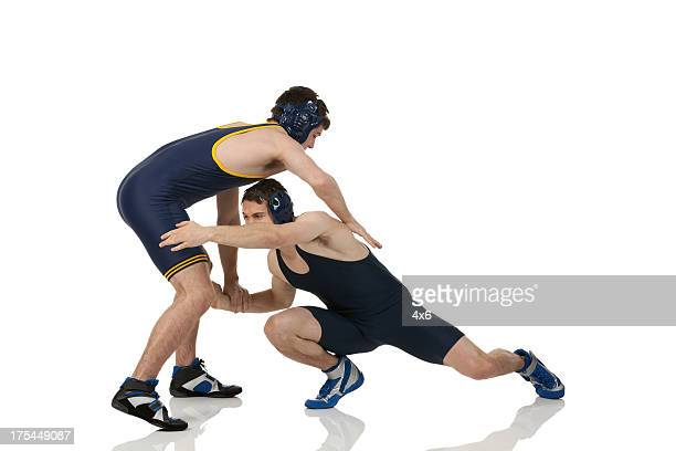 wrestlers in action - wrestling stock pictures, royalty-free photos & images