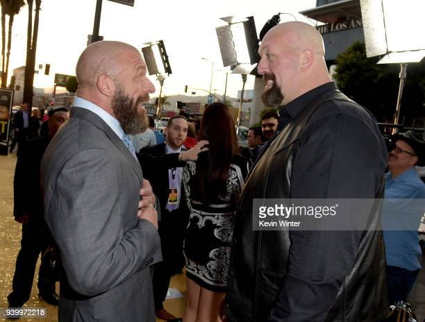 Wrestlers Paul 'Triple H' Levesque and Paul 'Big Show' Wright II arrive at the premiere of HBO's 'Andre The Giant' at the Cinerama Dome on March 29...