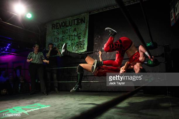Wrestlers perform during an all-female wrestling event on International Women's Day at the Resistance Gallery in Bethnal Green on March 8, 2019 in...