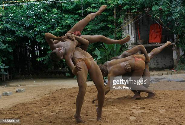 Wrestlers practice in the mud at a traditional wrestling center in Allahabad Traditional Indian wrestling is ancient subculture where wrestlers live...