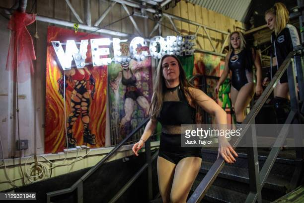 Wrestlers prepare to perform during an allfemale wrestling event on International Women's Day at the Resistance Gallery in Bethnal Green on March 8...