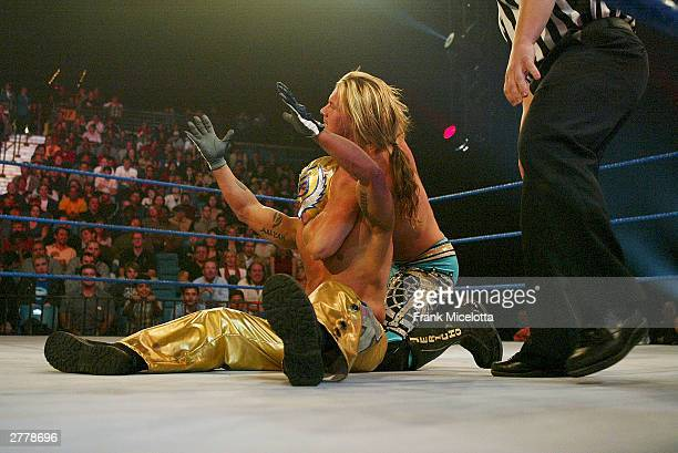 WWE wrestlers Rey Mysterio and Chris Jericho perform on stage during the 1st Annual Video Game Awards at the MGM Grand Garden Arena December 2 2003...