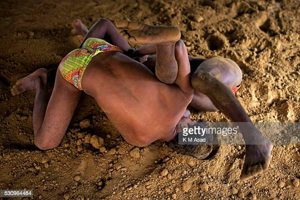 Wrestlers take daily practice in the early morning in Kashi ghat near the Gongha River in Varanasi India November 29 2014 The ancient tradition of...