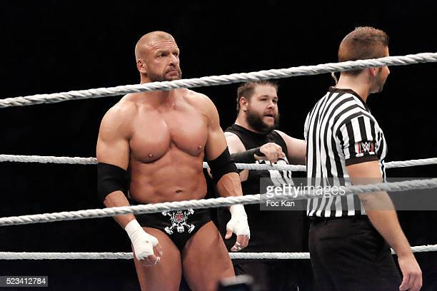 Wrestlers Tripple H and Kevin Owens perform during 'WLIVE REVENGE' Wrestlemania Show Party at Hotel Accor Arena Bercy on April 22 2016 in Paris France
