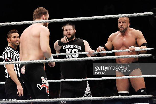 Wrestlers Tripple H Kevin Owens and Sami Zain perform during 'WLIVE REVENGE' Wrestlemania Show Party at Hotel Accor Arena Bercy on April 22 2016 in...