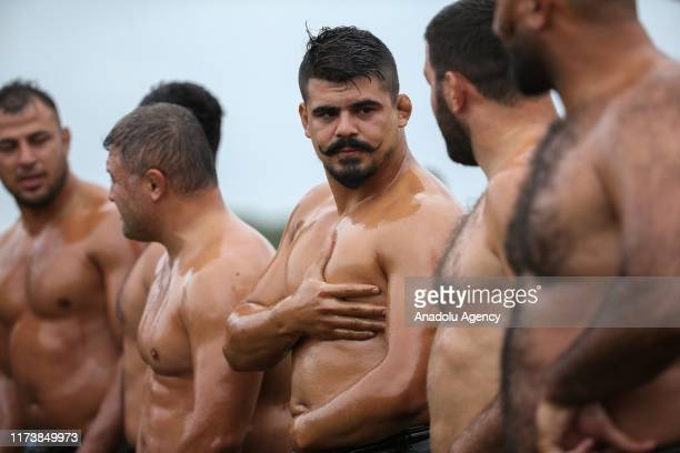 Wrestlers wait to compete in a oil wrestling match during the 4th Etnospor Culture Festival held at Ataturk Airport Istanbul Turkey on October 05...
