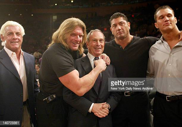WWE wrestlers with the Mayor Michael Bloomberg Ric Flair Triple H Mayor Bloomberg Batista and Randy Orton at Madison Square Garden for the New York...