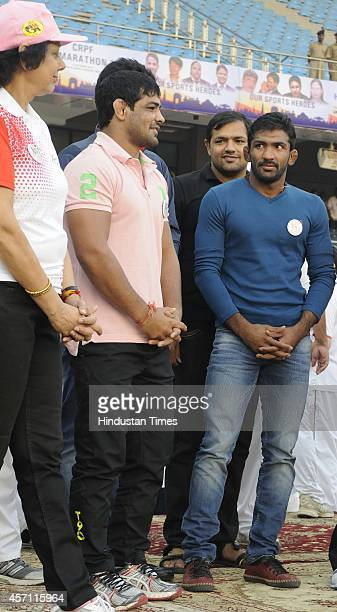 Wrestlers Yogeshwar Dutt, and Sushil Kumar during the flag-off ceremony of CRPF Half Marathon- Run for Unity as a part of the 75th Raising Day...