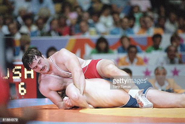 Wrestling: 1984 Summer Olympics, USA Bruce Baumgartner in action during 220 lb Freestyle Gold Medal match vs Canada Bob Molle at Anaheim Convention...