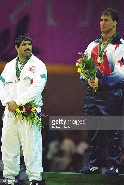 Wrestling 1996 Summer Olympics USA Kurt Angle victorious with gold medal after 220 pound freestyle match vs IRN Abbas Jadidi Atlanta GA 7/31/1996